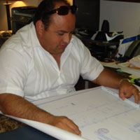 Sugar Land home remodeling and home construction expert George Villarreal reviewing plans.